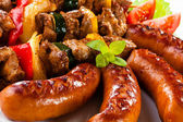 Grilled meat, sausages and vegetables — Stock Photo