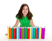 Girl behind pile of books isolated on white background — Stock Photo