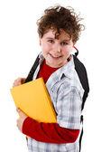 Ung pojke håller böcker isolerad på vit — Stockfoto