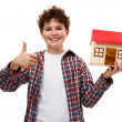 Boy holding model of house isolated on white — Stock Photo #18201019