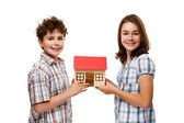 Kids holding model of house isolated on white — 图库照片