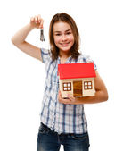 Girl holding model of house isolated on white — Stock Photo