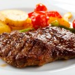 Grilled steak, baked potatoes and vegetables — Stock Photo #18262573