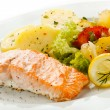 Roasted salmon and vegetables - Stock Photo