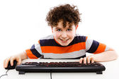 Boy using computer isolated on white background — Stock Photo