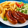 Grilled sausages, French fries and vegetables — Stock Photo #20795613