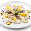 Marinated herring fillets with cream and vegetables — Stock Photo
