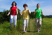 Nordic walking - active family walking outdoor — ストック写真