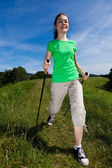 Nordic walking - active girl outdoor — Stock Photo