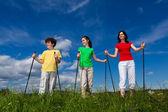 Nordic walking - active family walking outdoor — Стоковое фото