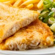 Stock Photo: Fish dish - fried fish fillet, French fries with vegetables