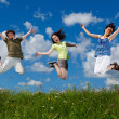 Active family - mother and kids running, jumping outdoor — Foto Stock