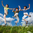 Active family - mother and kids running, jumping outdoor — Stock Photo #21041303