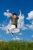 Girl jumping, running against blue sky — Стоковое фото