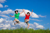 Girl and boy running, jumping outdoor — Стоковое фото