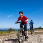 Girls riding bikes — Stock Photo #21107197