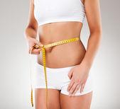 Woman measuring her slim body — Stock Photo