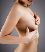 Woman examining her breast — Stock Photo