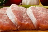 Fresh raw pork on cutting board — Stock Photo