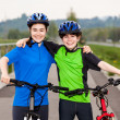 Girl and boy biking — Stock Photo