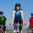 Active family biking — Stock Photo
