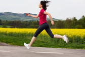 Woman running, jumping outdoor — Stock Photo
