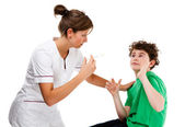 Nurse giving young boy injection isolated on white background — Stock Photo