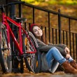 Urban biking - teenage girl and bike in park — Stock Photo #22550155