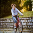 Stock Photo: Urbbiking - teenage boy and bike in city