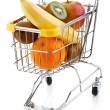 Shopping trolley full of oranges on white background — Stock Photo