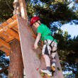 Boy climbing in adventure park — Stock Photo