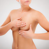 Woman examining her breast — Stock Photo