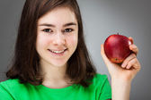 Girl holding apple — Stock Photo
