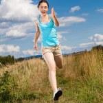 Girl running, jumping outdoor — Stock Photo