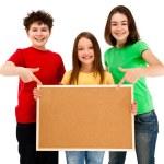 Kids holding noticeboard isolated on white background — Stock Photo