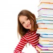 Girl peeking behind pile of books on white background — Stock Photo #22638447