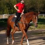 Girl riding horse — Stock Photo