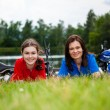 Girls resting after bicycle ride  — Stock Photo