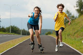 Active young - rollerblading, running — Stock Photo