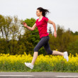 Stock Photo: Woman running, jumping outdoor