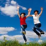 Women running, jumping outdoor — Stock Photo
