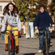 Urban biking - teens riding bikes in city — Stock Photo