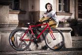 Urban biking - teenage girl and bike in city — Stock Photo