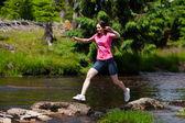Woman running, jumping outdoor — Stock Photo