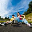 Active young - rollerblading, skateboarding — Stock Photo