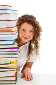 Young woman behind pile of books isolated on white background — Stock Photo