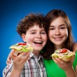 Stock Photo: Kids eating big sandwiches