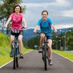 Girls riding bikes — Stock Photo #26428331