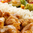 Fried chicken nuggets, white rice and vegetables — Stock Photo #26429683