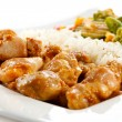 Fried chicken nuggets, white rice and vegetables — Stock Photo #26430399